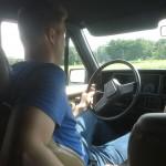 Rich achter het stuur